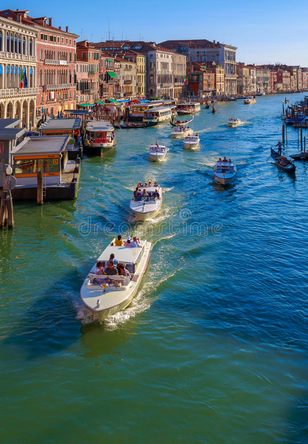 Crowded Canal Grande-Venice. Crowd of happy people or tourists on motorboats-Canal Grand Venice