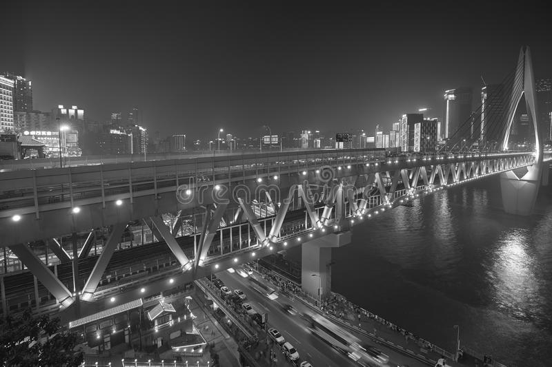 Crowded Chongqing city downtown shrouded in smog at night. royalty free stock images