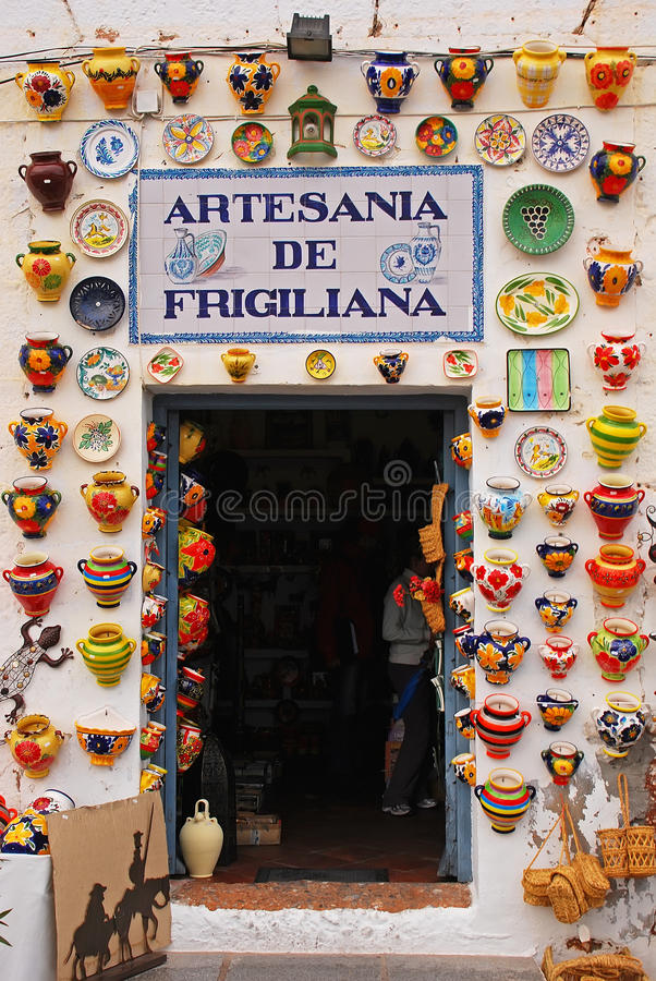 Free Crowded Colorful Pottery Displayed On Shop Entrance At Frigiliana, Spain Royalty Free Stock Photo - 86501565