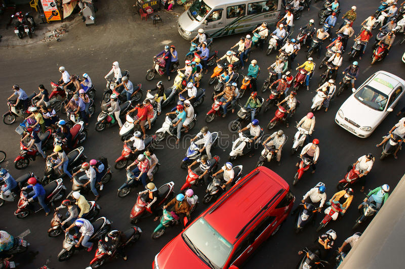 Crowded, dense with motorbike in Viet nam. HO CHI MINH CITY, VIET NAM- MAR 27: Dense, crowed scene of urban traffic in rush hour, crowd of people wear helmet stock photos