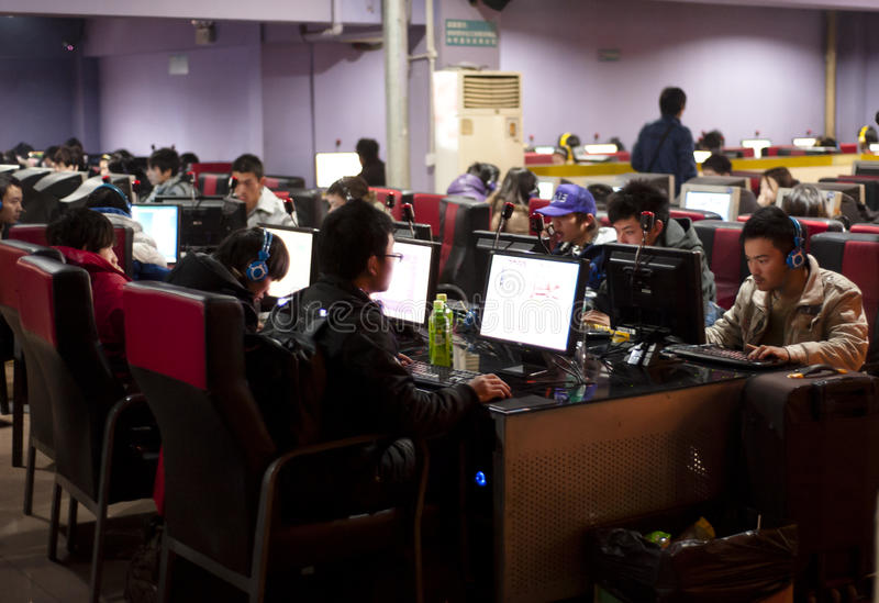 A crowded internet cafe in China. An internet cafe in Chengdu on Jan 28, 2011. In this picture an open-space with many chinese people surfing the web on fixed stock photos