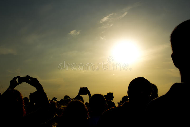 Crowded People. With A Backlight stock image