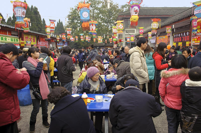 Crowded people to eat food on snack street stock image