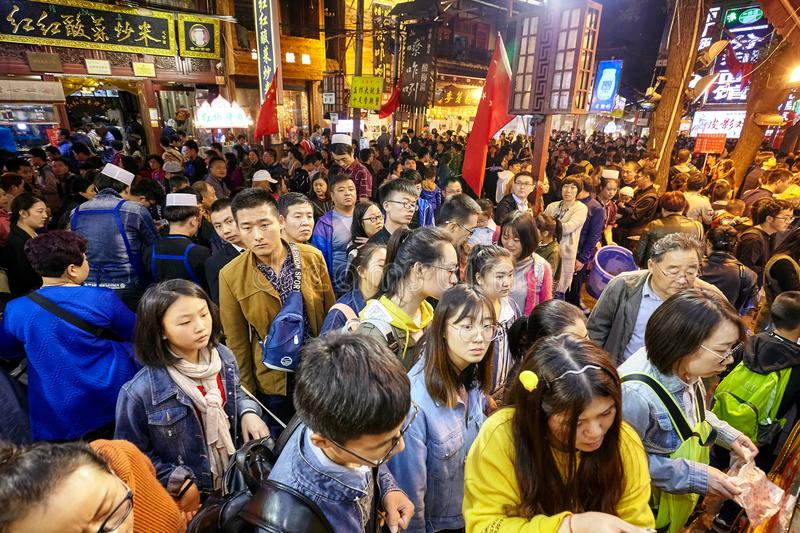 Crowded people wait to order street food in the Muslim Quarter. Xian, China - October 5, 2017: Crowded people wait to order street food in the Muslim Quarter royalty free stock photos
