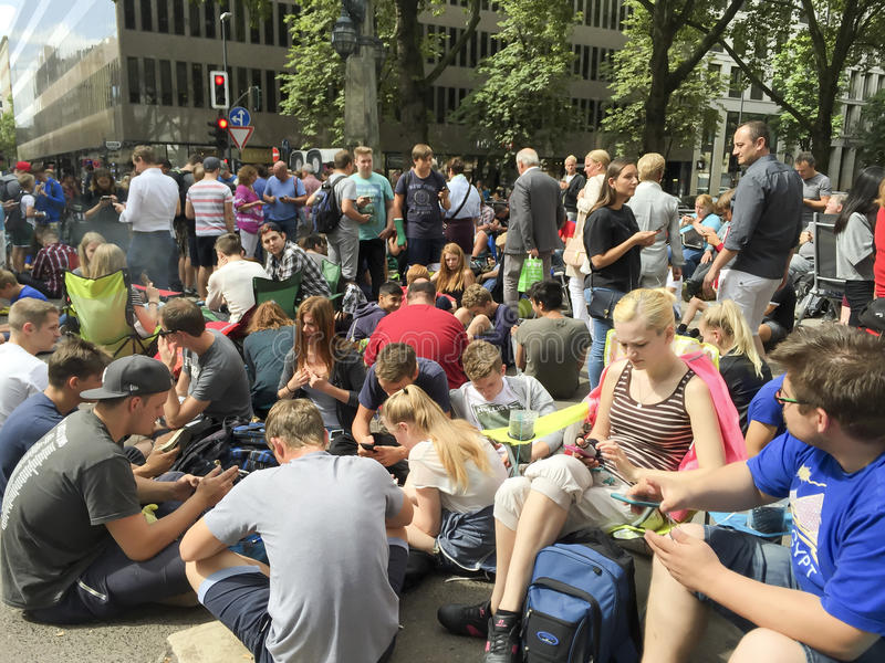 Crowded Pokemon-Go Hotspot. Pokemon-Go hotspot in Dusseldorf on Koenigsallee, Avenue Koe stock photography