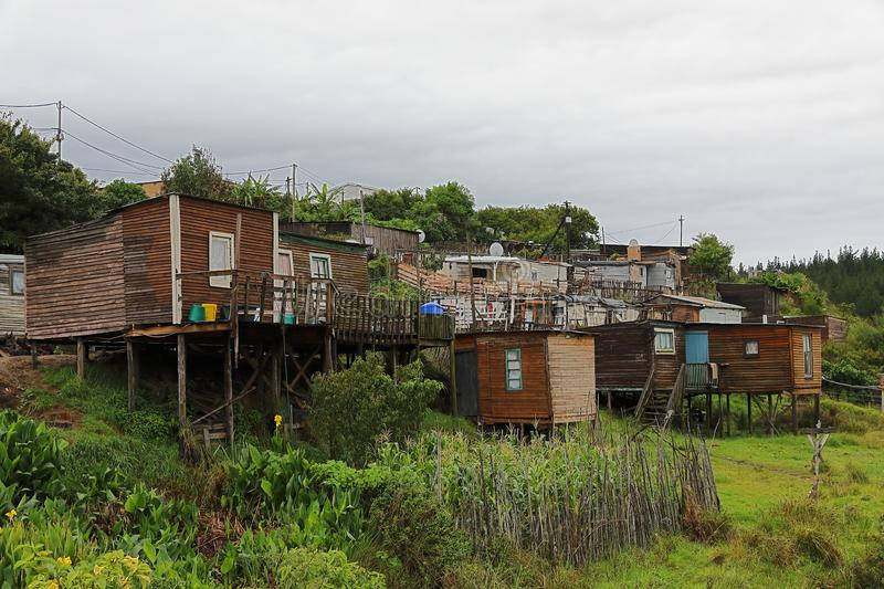 Crowded, poor and very shaky shacks royalty free stock image