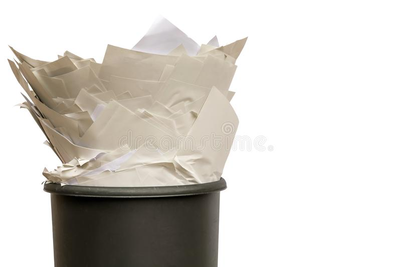 Full trash against white background with copy space. Crowded recycle bin as a cut-out royalty free stock image