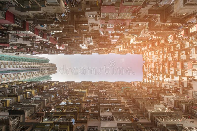 Crowded residence bottom view Hong Kong residence area. Cityscape background royalty free stock image