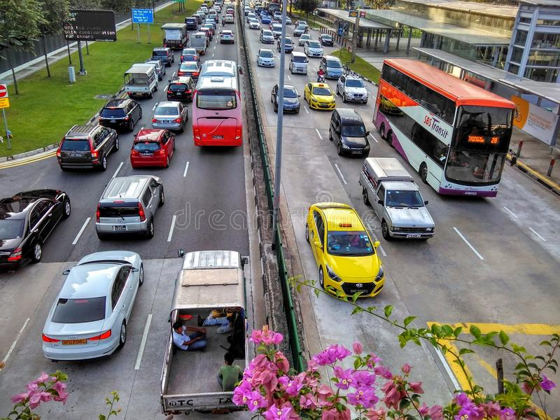 Crowded roads in Singapore. Traffic congestion during morning peak hours at Bartley Road in front of Bartley MRT station in Singapore stock photos