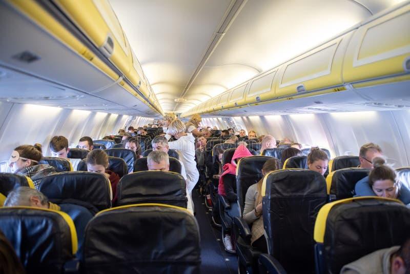 TEL AVIV, ISRAEL - DECEMBER 08, 2018: Crowded Ryanair Flight. Boeing 737-800 interior stock images