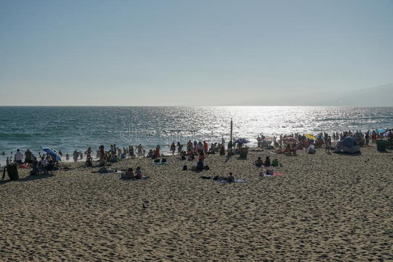 Crowded Santa Monica beach with tourist and families enjoying the summer royalty free stock photography