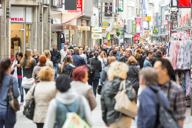 Crowded shopping street in Cologne. COLOGNE,GERMANY - MAY 07,2014: Crowded shopping street in Cologne royalty free stock images