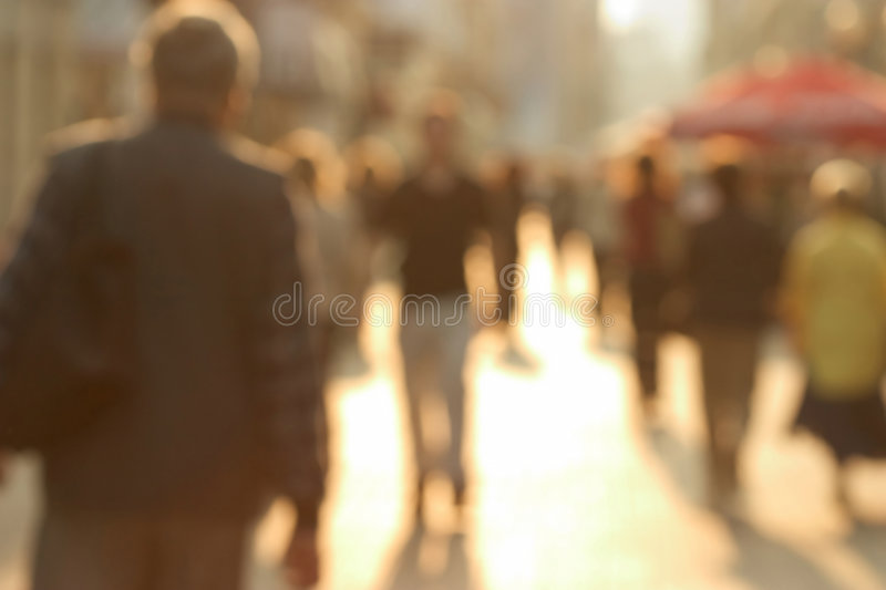 Crowded street. Busy european street. Purposely blurred with a lens stock image