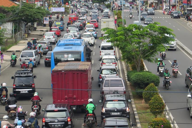 Crowded street in Depok. DEPOK, INDONESIA - March 10, 2017: Congested traffic on Jalan Margonda royalty free stock images