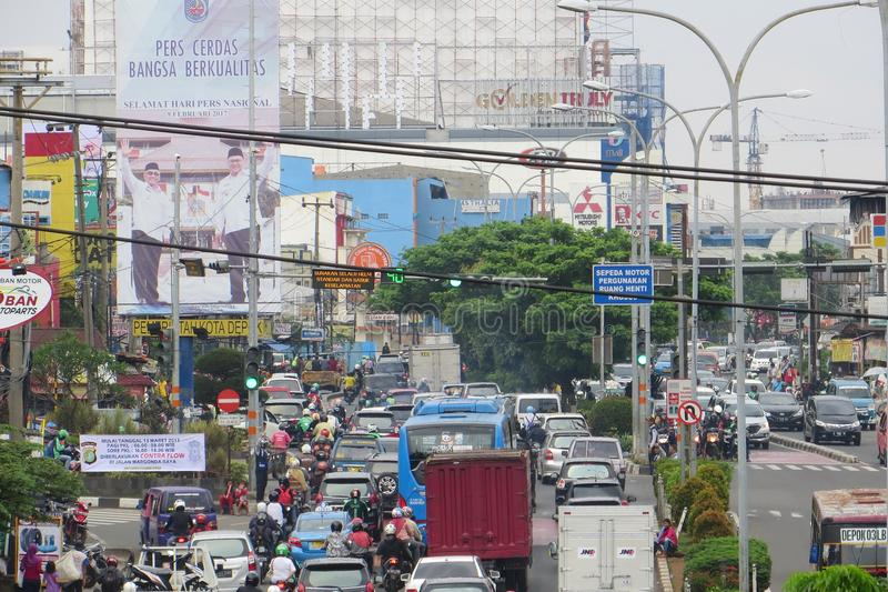Crowded street in Depok. DEPOK, INDONESIA - March 10, 2017: Congested traffic on Jalan Margonda royalty free stock photography