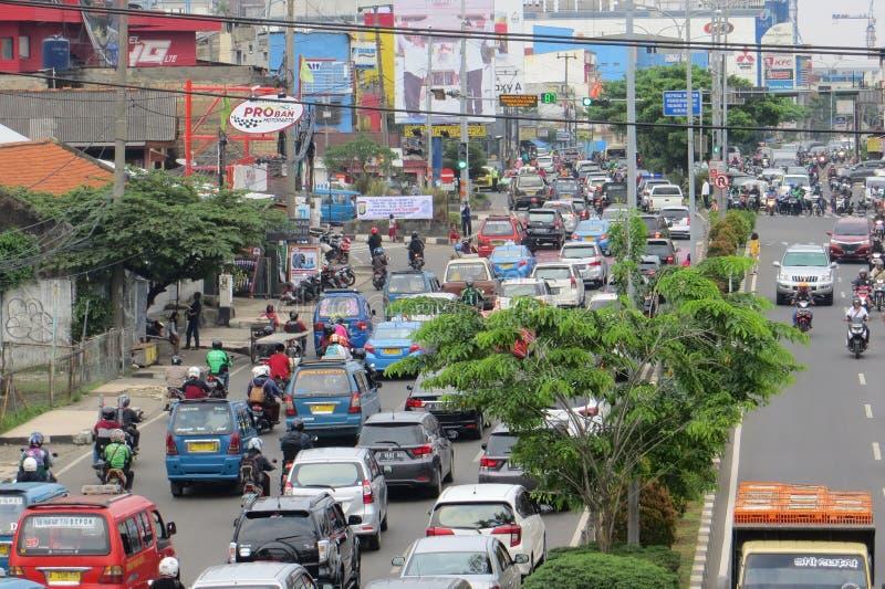 Crowded street in Depok. DEPOK, INDONESIA - March 10, 2017: Congested traffic on Jalan Margonda royalty free stock photos