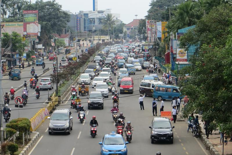 Crowded street in Depok. DEPOK, INDONESIA - March 10, 2017: Congested traffic on Jalan Margonda stock images