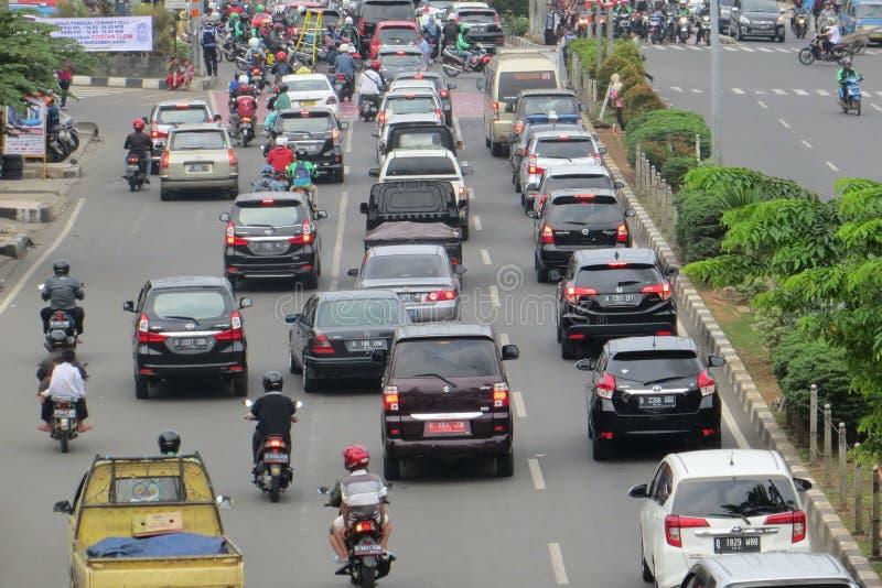 Crowded street in Depok. DEPOK, INDONESIA - March 10, 2017: Congested traffic on Jalan Margonda stock image