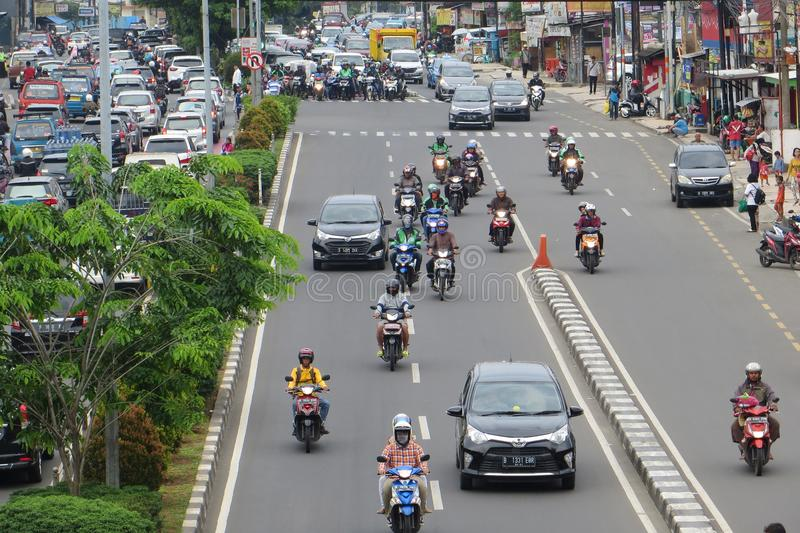 Crowded street in Depok. DEPOK, INDONESIA - March 10, 2017: Congested traffic on Jalan Margonda stock photo