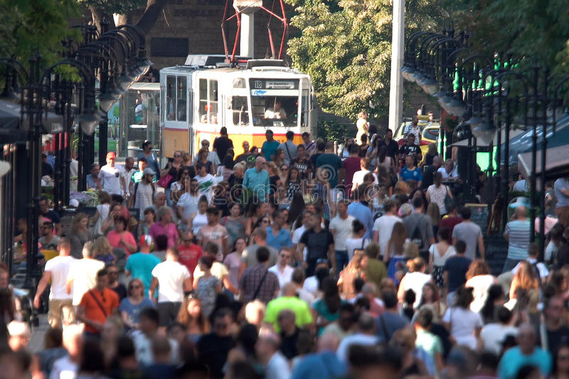 Crowded street with people and a tram car stock photos