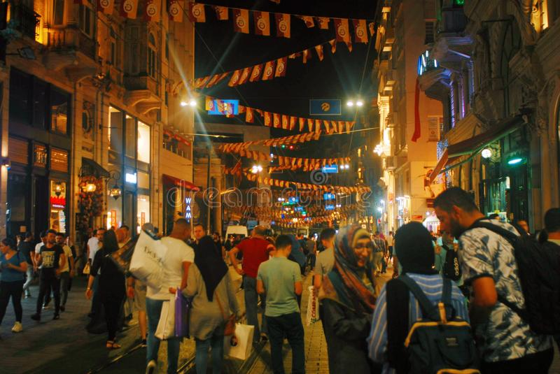 Crowded Street in Turkey. Travel, fun, joy, tourism, locals, turkish, galatasaray, footbal, chaos, shopping, world, people, lights, night, dark royalty free stock image