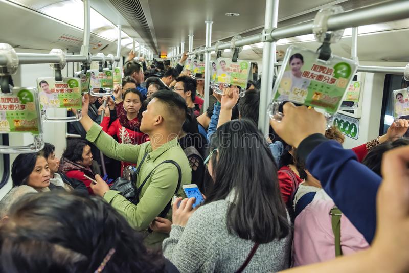 Crowded subway train carriage, Shanghai China stock images