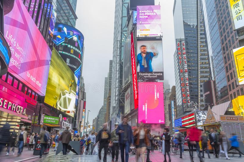 Crowded of tourist walking in Times Square with LED signs stock images