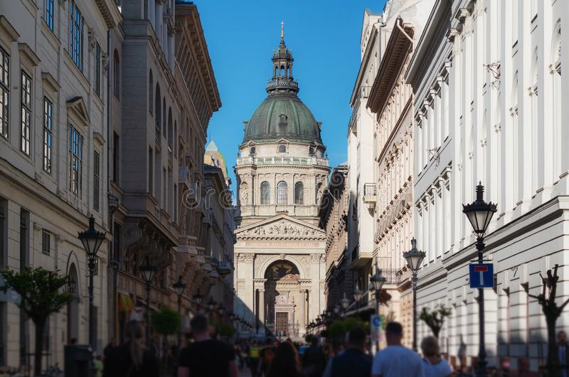 Crowded tourist at Zrinyi Utca street with Saint Stephen`s Basilica in Budapest, Hungary. Crowded tourists at Zrinyi Utca street with Saint Stephen`s Basilica in stock photo