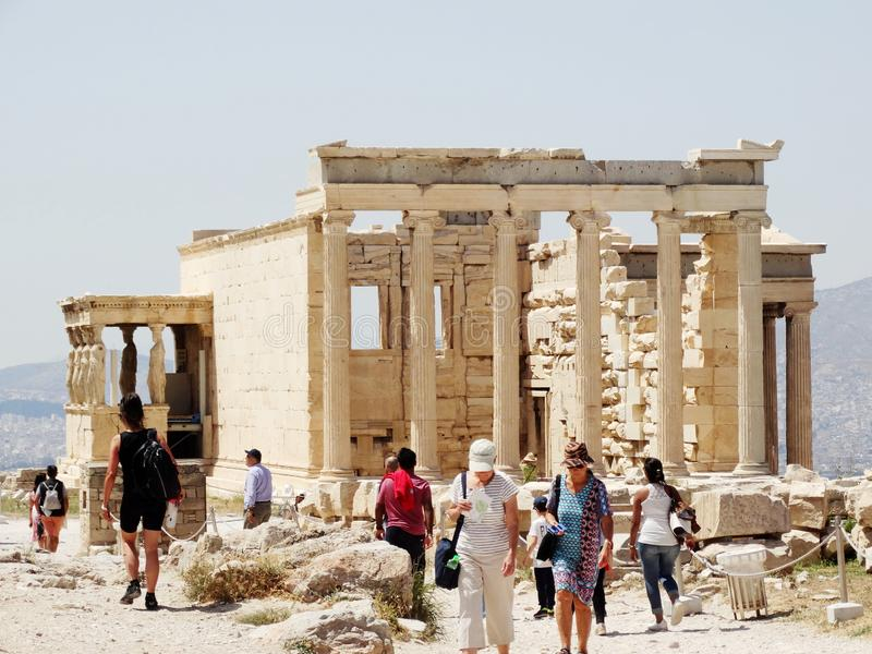 Crowded tourists visit The Erechtheum Temple in Acropolis hill in Athens, Greece. royalty free stock photos