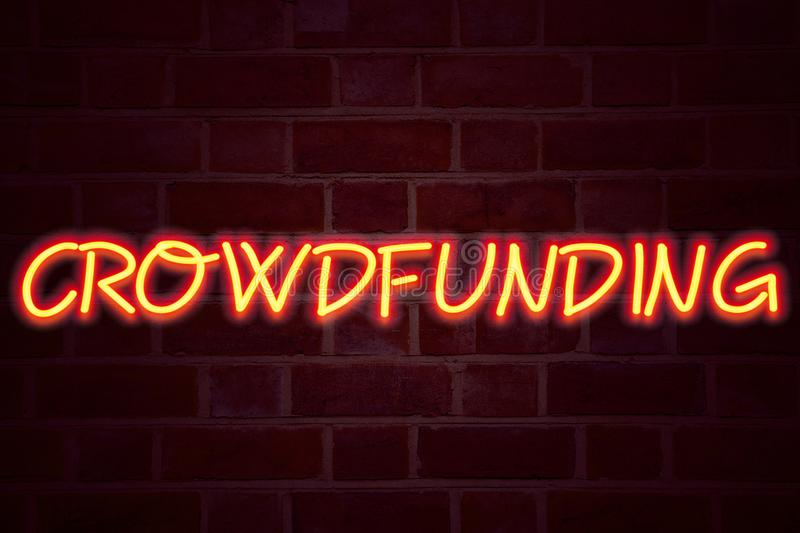 Crowdfunding neon sign on brick wall background. Fluorescent Neon tube Sign on brickwork Business concept for Business Fundraising. Project Funding 3D rendered stock photos