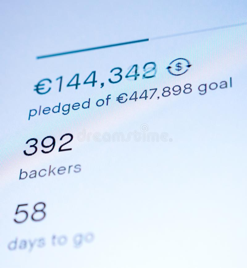 Crowdfunding web-page featuring pledged and goal sum royalty free stock image