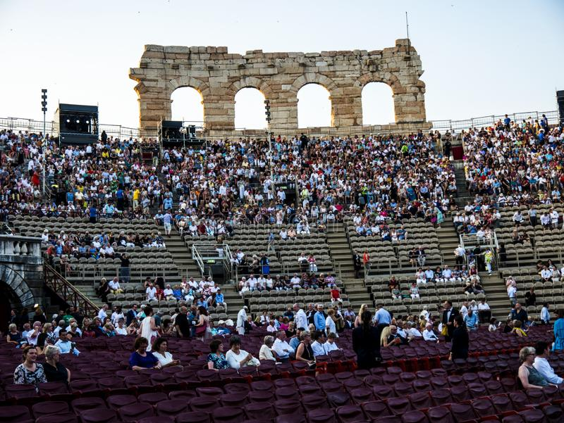 The crowds begin to gather for a visit to the opera in the Roman Amphitheatre royalty free stock photography