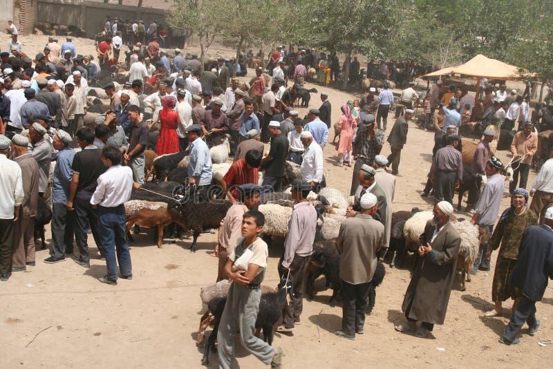 Crowds on busy uighur market stock photos