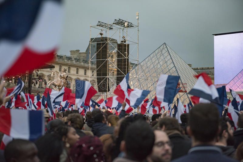 Crowds celebrate Macron`s victory at the Louvre Museum. Paris, France - May 7, 2017: Crowds celebrate Macron`s victory at the Louvre Museum after presidential royalty free stock image