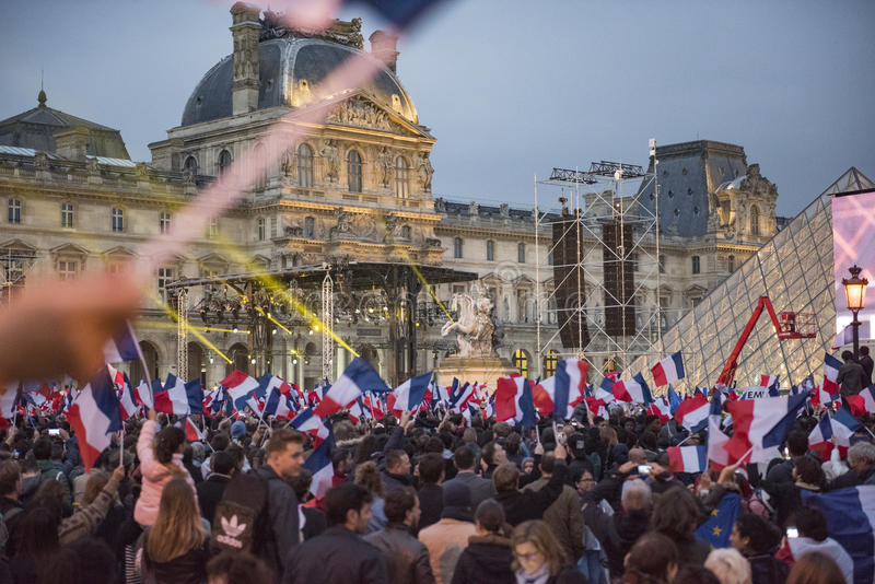 Crowds celebrate Macron`s victory at the Louvre Museum. Paris, France - May 7, 2017: Crowds celebrate Macron`s victory at the Louvre Museum after presidential stock photos