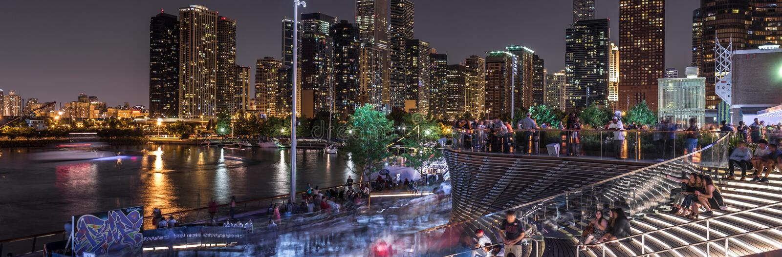 Crowds at Chicago`s navy pier. Chicago, US - July 17, 2016: Long exposure of crowds of people gathered at the Navy pier to watch a fireworks display royalty free stock image