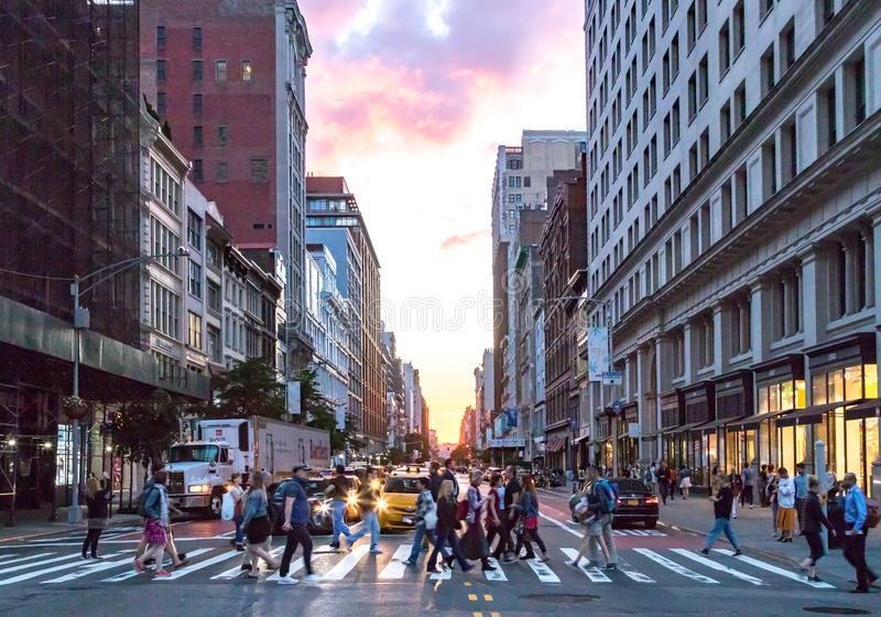 Crowds of diverse people cross the busy intersection on 23rd Street and 5th Avenue in Manhattan New York City stock images