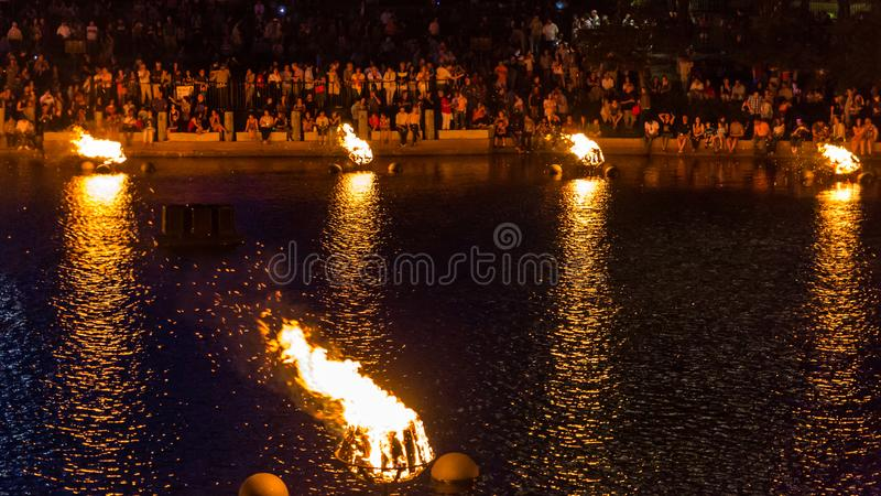 Crowds enjoy the glow of the WaterFire display. stock photo