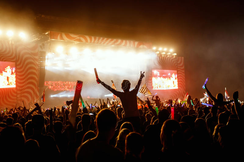 Crowds Enjoying Themselves At Outdoor Music Festival royalty free stock photography
