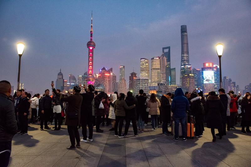Crowds gather at Waitan to view the Oriental Pearl Tower. The Oriental Pearl Radio & Television Tower is a TV tower in Shanghai. Its location at the tip of royalty free stock photography