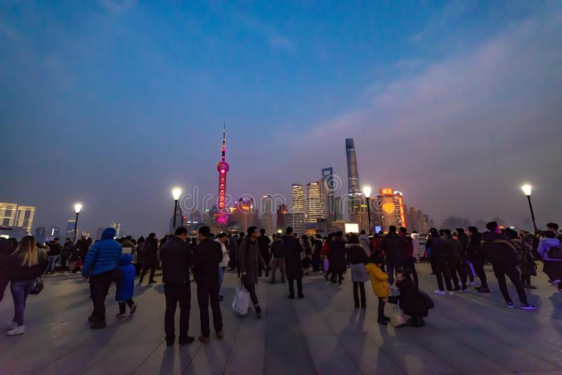 Crowds gather at Waitan to view the Oriental Pearl Tower. The Oriental Pearl Radio & Television Tower is a TV tower in Shanghai. Its location at the tip of royalty free stock photo