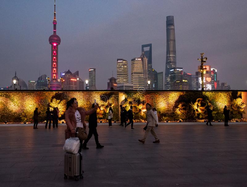 Crowds gather at Waitan to view the Oriental Pearl Tower. The Oriental Pearl Radio & Television Tower is a TV tower in Shanghai. Its location at the tip of stock photography
