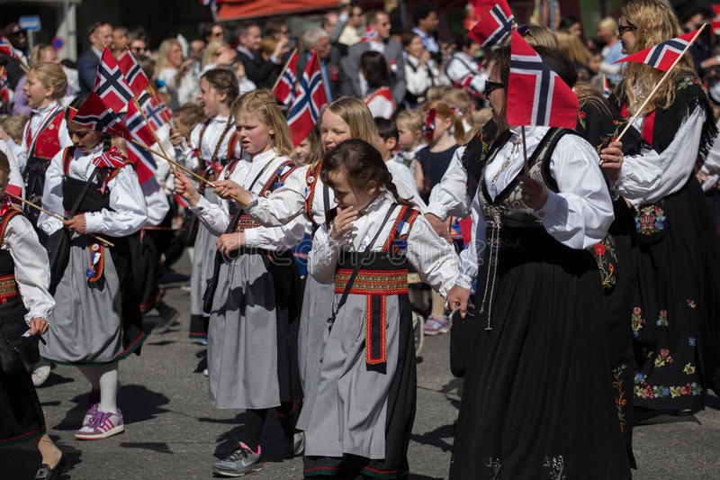 Crowds lining the street for the Children`s parade on Norway`s National Day, 17th of May royalty free stock photos