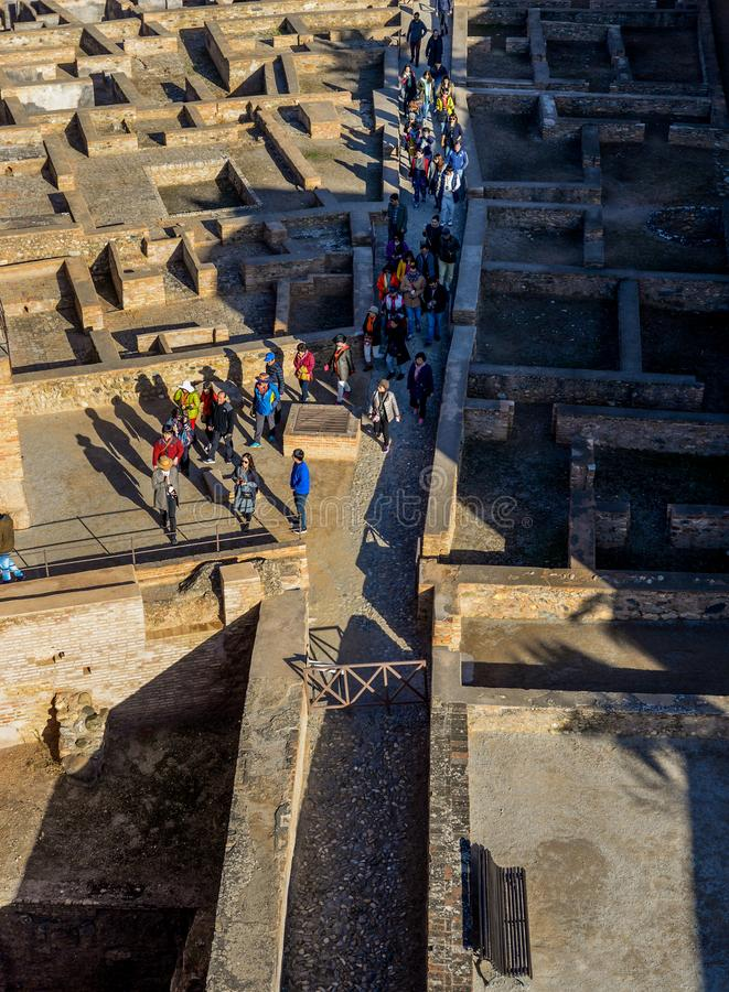 The crowds moving through the ruins. Huge numbers of people moving through the ruins at Alahambra - Granada, Spain stock photo