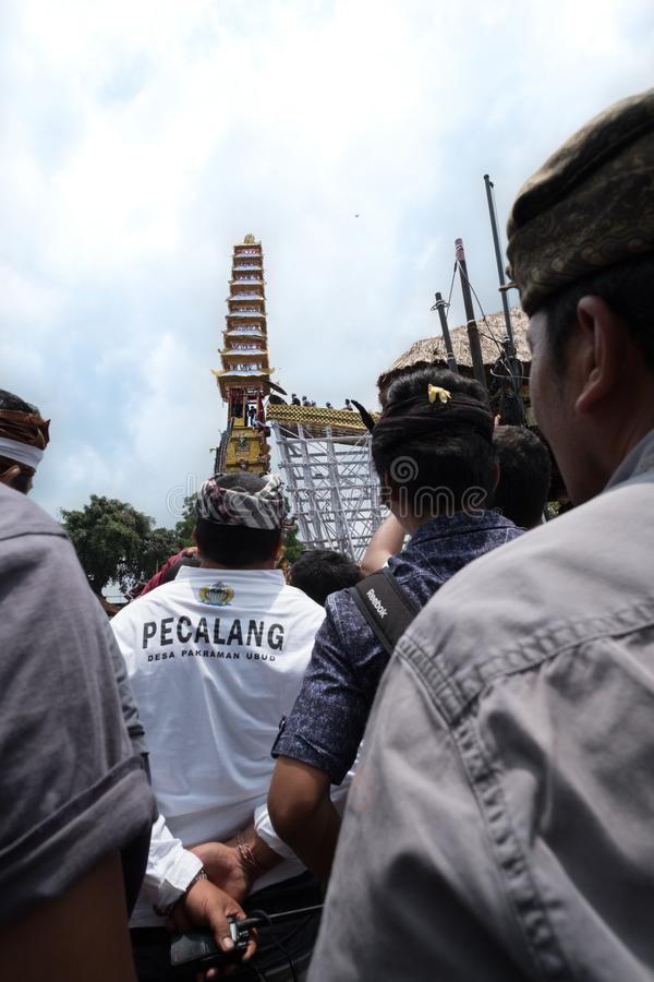Crowds and officials in Ubud, Bali gather in front of the Bade cremation tower - 2nd March 2018 royalty free stock image