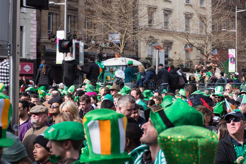 Crowds of people in Irish style hats and green clothes in Dublin, Ireland on St. Patrick`s Day. Crowds of people in Irish style hat and green clothes in Dublin royalty free stock image