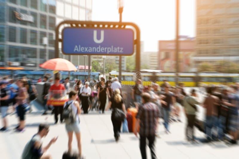 Crowds of people in motion blur - Alexanderplatz in Berlin city royalty free stock photo