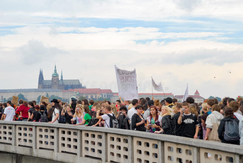 Crowds of people protesting again local ministry on a bridge with view of Prague castle stock photos