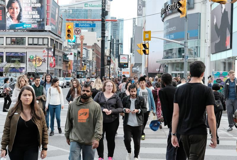 Crowds of people seen shopping in a Canadian city. royalty free stock image