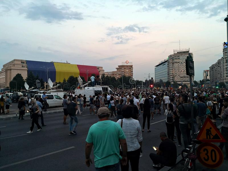 People protest against corruption and abuse. Crowds of Romanian people have gathered in front of Government building to protest against abuse in regard to royalty free stock images